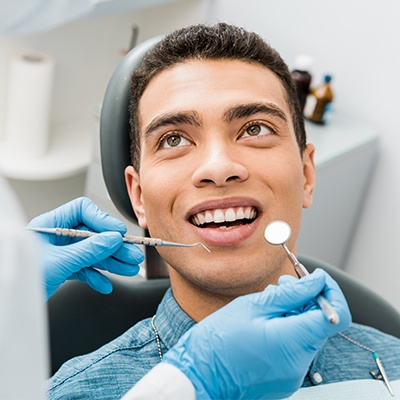 man having teeth cleaning done