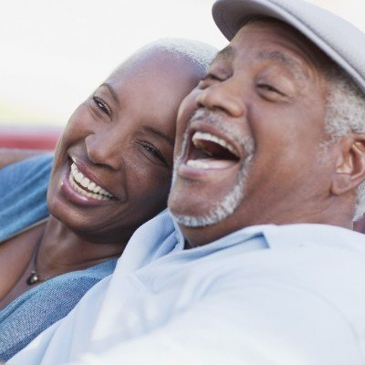 Laughing couple with dental implants in Reynoldsburg