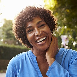 healthy woman with dental implants in Reynoldsburg