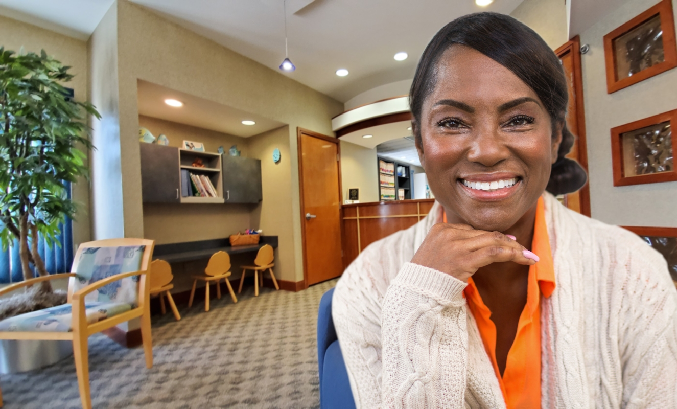 woman showing off perfect smile in Reynoldsburg dental office