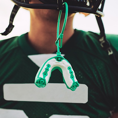 mouthguard hanging off helmet